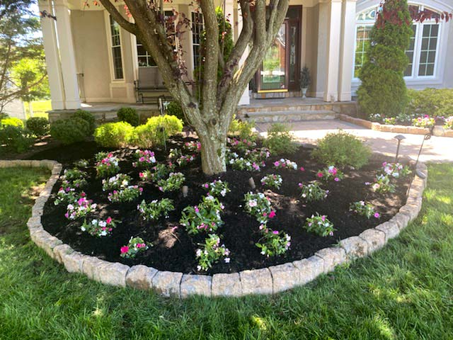 Landscape bed installation with mulch and flowering plants in Warrenton, VA.