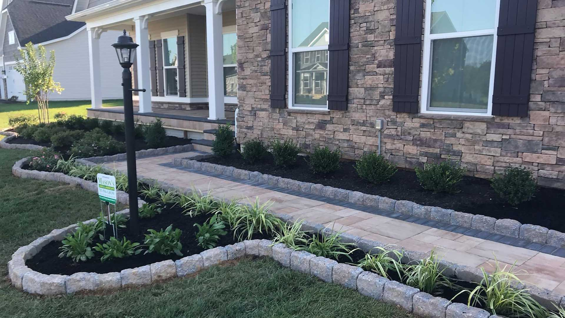 Custom, curvy landscape bed with plants in Warrenton, VA.